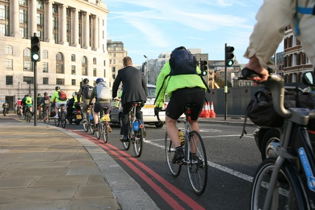 London, UK - October 7, 2010 : Commuter's on rental bike. London's bicycle sharing scheme, to help ease traffic congestion, sponsored by Barclays, was launched on 30 July 2010. Currently there are some 6,000 bikes and 400 docking stations in London.     Éditoriale