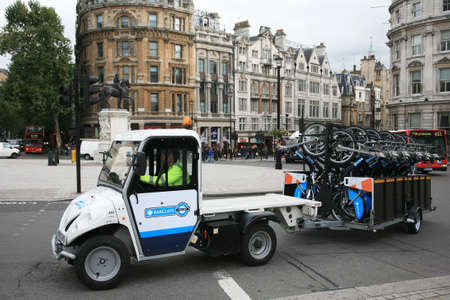 at ease: London, UK - October 18, 2010 : Bicycle collect car. Londons bicycle sharing scheme, to help ease traffic congestion, sponsored by Barclays, was launched on 30 July 2010. Currently there are some 6,000 bikes and 400 docking stations in London.  Editorial