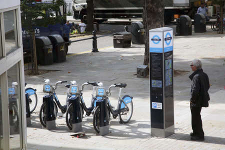at ease: London, UK - September 2, 2010 : Londons bicycle sharing scheme, to help ease traffic congestion, sponsored by Barclays, was launched on 30 July 2010. Currently there are some 6,000 bikes and 400 docking stations in London.