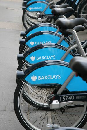 London, UK - August 12, 2010 : London's bicycle sharing scheme, to help ease traffic congestion, sponsored by Barclays, was launched on 30 July 2010. Currently there are some 6,000 bikes and 400 docking stations in London.    Stock Photo - 12818178