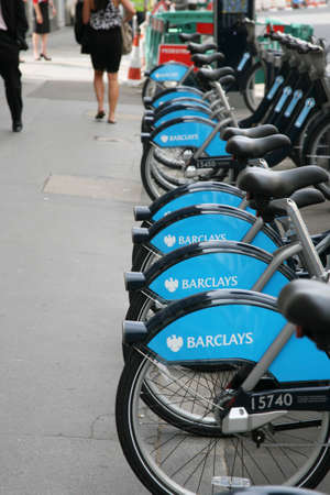 London, UK - August 12, 2010 : London's bicycle sharing scheme, to help ease traffic congestion, sponsored by Barclays, was launched on 30 July 2010. Currently there are some 6,000 bikes and 400 docking stations in London.    Stock Photo - 12818193