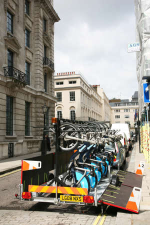 boris: London, UK - August 13, 2010 : Bicycle collect car. Londons bicycle sharing scheme, to help ease traffic congestion, sponsored by Barclays, was launched on 30 July 2010. Currently there are some 6,000 bikes and 400 docking stations in London.