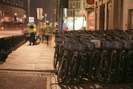 at ease: London, UK - November 1, 2010 : Londons bicycle sharing scheme, to help ease traffic congestion, sponsored by Barclays, was launched on 30 July 2010. Currently there are some 6,000 bikes and 400 docking stations in London.    Editorial