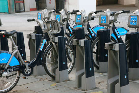 at ease: London, UK - November 16, 2010 : Londons bicycle sharing scheme, to help ease traffic congestion, sponsored by Barclays, was launched on 30 July 2010. Currently there are some 6,000 bikes and 400 docking stations in London.