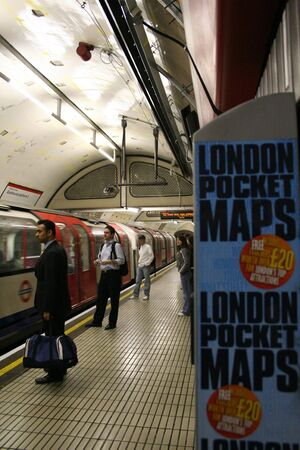 London, UK - May 6, 2006: Inside view of the Underground Tube System, the oldest underground railway in the world, covering 402 km of tracks.  Stock Photo - 13021203