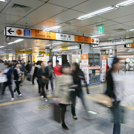 Seoul, South Korea - April 23, 2011: Inside view of the Metropolitan Subway in Seoul, one of the most heavily used underground rail systems in the world, service 8 million passengers daily.  Stock Photo - 13021199