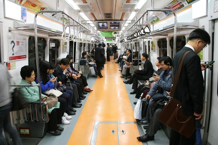 Seoul, South Korea - April 26, 2011: Inside view of the Metropolitan Subway in Seoul, one of the most heavily used underground rail systems in the world, service 8 million passengers daily.  Éditoriale