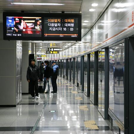 Seoul, South Korea - April 22, 2011: Inside view of the Metropolitan Subway in Seoul, one of the most heavily used underground rail systems in the world, service 8 million passengers daily.  Stock Photo - 13021200