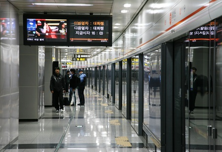 Seoul, South Korea - April 22, 2011: Inside view of the Metropolitan Subway in Seoul, one of the most heavily used underground rail systems in the world, service 8 million passengers daily.