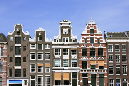 Old colorful medieval buildings, in Amsterdam, over blue sky  photo