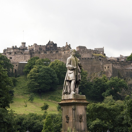 Allan Ramsay Statue and Edinburgh castle, one of the most tourists attract places in Edinburgh, UK