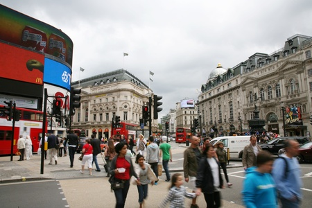 famous place: London, UK - August 12, 2010: View of Piccadilly Circus, famous road junction, built in 1819, meeting place, tourist attraction, in West End, inks to Shaftesbury Avenue, Regent Street, Haymarket, Leicester Square and Glasshouse Street.  Editorial