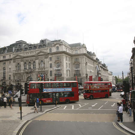 London, UK - August 12, 2010: View of Piccadilly Circus, famous road junction, built in 1819, meeting place, tourist attraction, in West End, inks to Shaftesbury Avenue, Regent Street, Haymarket, Leicester Square and Glasshouse Street.  Stock Photo - 13257024