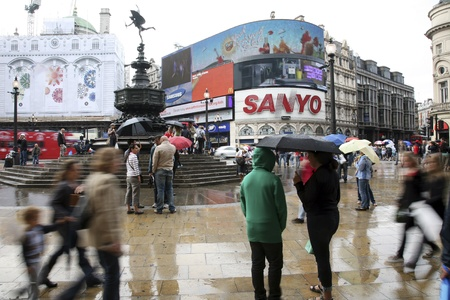 the place of interest: London, UK - August 13, 2010: Tourists in Piccadilly Circus, famous tourist attraction, road junction, built in 1819, meeting place, tourist attraction, in West End, inks to Shaftesbury Avenue, Regent Street, Haymarket, Leicester Square and Glasshouse Str