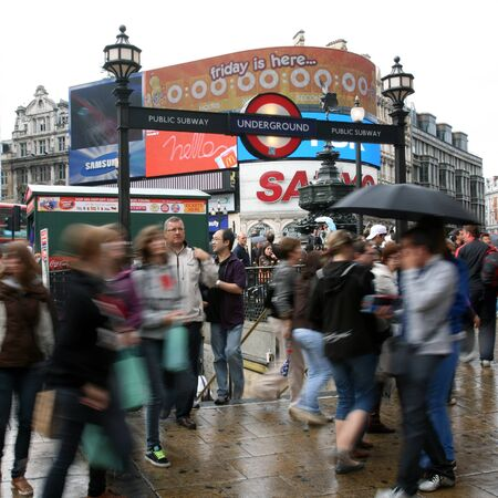London, UK - August 13, 2010: Tourists in Piccadilly Circus, famous tourist attraction, road junction, built in 1819, meeting place, tourist attraction, in West End, inks to Shaftesbury Avenue, Regent Street, Haymarket, Leicester Square and Glasshouse Str Stock Photo - 13257023