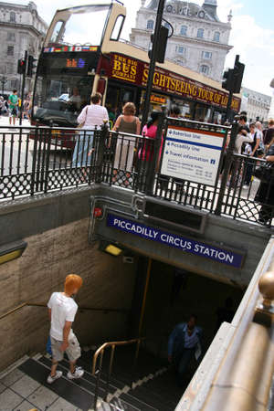 shaftesbury: London, UK - July 21, 2010: View of Piccadilly Circus, famous road junction, built in 1819, meeting place, tourist attraction, in West End, inks to Shaftesbury Avenue, Regent Street, Haymarket, Leicester Square and Glasshouse Street.