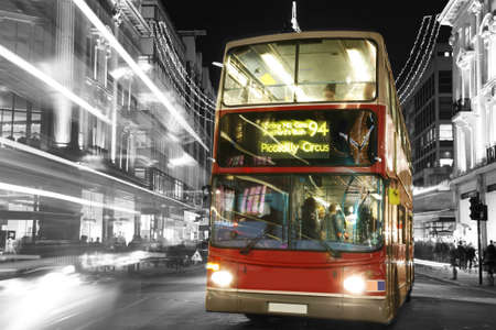 Double Decker Bus, most iconic symbol of London, in Oxford Street at Night.  Stock Photo - 13460560