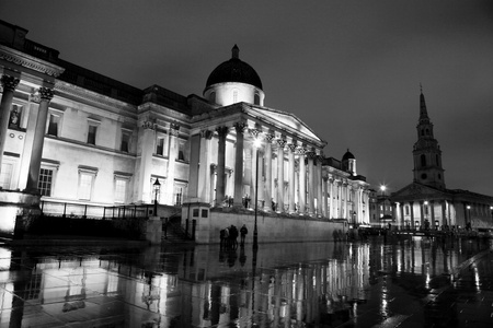 National Gallery seen from Trafalgar Square in the late time of rainny day  photo