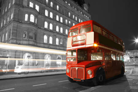 black and white: Route Master Bus in the street of London. Route Master Bus is the most iconic symbol of London as well as Londons Black cabs.