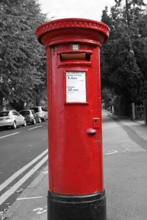 Traditional British red post box photo