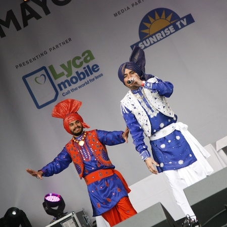 London, UK - May 6, 2012: Performers take part in the festival of Vaisakhi, celebrating the birth of the Sikhs, celebrated across northern India especially Punjab region, in Trafalgar Square, London.   Stock Photo - 13537817