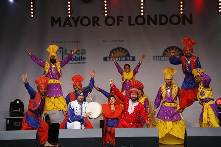 London, UK - May 6, 2012: Performers take part in the festival of Vaisakhi, celebrating the birth of the Sikhs, celebrated across northern India especially Punjab region, in Trafalgar Square, London.   Stock Photo - 13537842