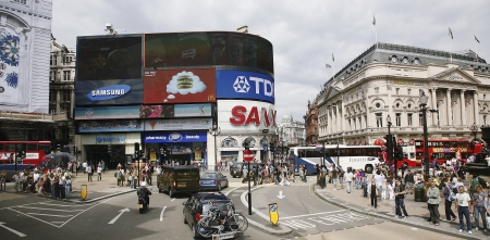 London, UK - August 2, 2010: View of Piccadilly Circus, famous road junction, built in 1819, meeting place, tourist attraction, in West End, inks to Shaftesbury Avenue, Regent Street, Haymarket, Leicester Square and Glasshouse Street.
