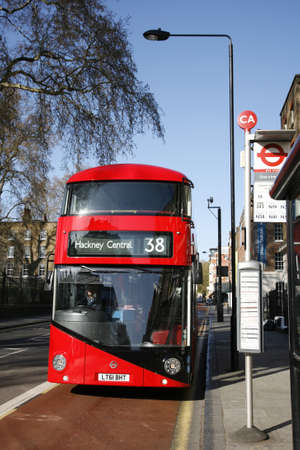 London, UK - April 15, 2012 : New Bus For London, also called Boris Bus or hybrid NB4L, 50% more fuel efficient than existing diesel buses. is 21st century replacement of the iconic Routemaster as a bus built specifically for use in London.   Stock Photo - 13714997