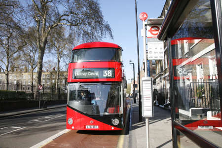 route master bus: London, UK - April 15, 2012 : New Bus For London, also called Boris Bus or hybrid NB4L, 50% more fuel efficient than existing diesel buses. is 21st century replacement of the iconic Routemaster as a bus built specifically for use in London.