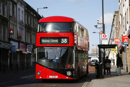 London, UK - April 15, 2012 : New Bus For London, also called Boris Bus or hybrid NB4L, 50% more fuel efficient than existing diesel buses. is 21st century replacement of the iconic Routemaster as a bus built specifically for use in London.   Stock Photo - 13714986