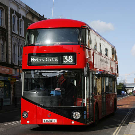 London, UK - April 15, 2012 : New Bus For London, also called Boris Bus or hybrid NB4L, 50% more fuel efficient than existing diesel buses. is 21st century replacement of the iconic Routemaster as a bus built specifically for use in London.   Stock Photo - 13714971