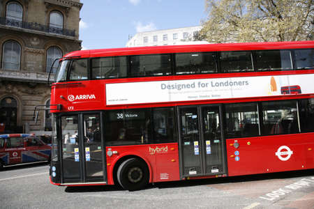 London, UK - April 15, 2012 : New Bus For London, also called Boris Bus or hybrid NB4L, 50% more fuel efficient than existing diesel buses. is 21st century replacement of the iconic Routemaster as a bus built specifically for use in London.