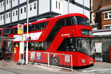 London, UK - April 30, 2012 : New Bus For London, also called Boris Bus or hybrid NB4L, is 21st century replacement of the iconic Routemaster as a bus built specifically for use in London.  Stock Photo - 13714991