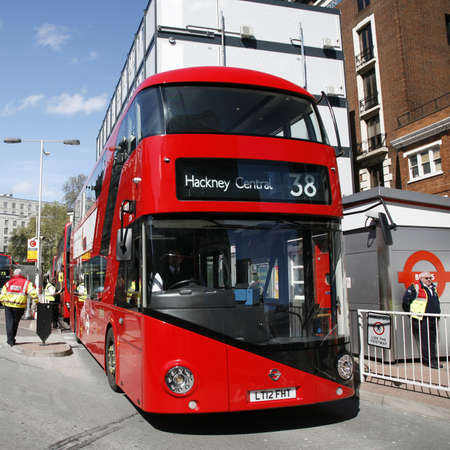 London, UK - April 30, 2012 : New Bus For London, also called Boris Bus or hybrid NB4L, is 21st century replacement of the iconic Routemaster as a bus built specifically for use in London.  Stock Photo - 13714978