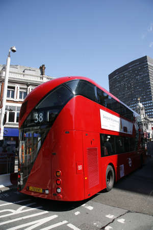 London, UK - April 30, 2012 : New Bus For London, also called Boris Bus or hybrid NB4L, is 21st century replacement of the iconic Routemaster as a bus built specifically for use in London.  Stock Photo - 13714985