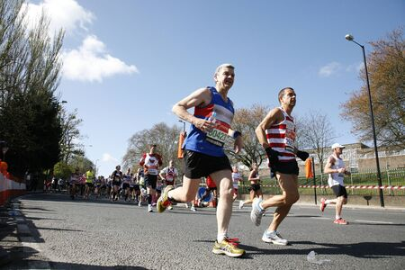 London, UK - April 22, 2012: Runners in London Marathon. The London Marathon is next to New York, Berlin, Chicago and Boston to the World Marathon Majors, the Champions League in the marathon. Stock Photo - 13745347