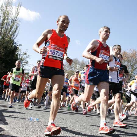 London, UK - April 22, 2012: Runners in London Marathon. The London Marathon is next to New York, Berlin, Chicago and Boston to the World Marathon Majors, the Champions League in the marathon.