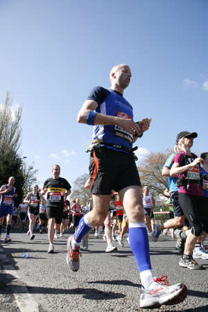 London, UK - April 22, 2012: Runners in London Marathon. The London Marathon is next to New York, Berlin, Chicago and Boston to the World Marathon Majors, the Champions League in the marathon. Stock Photo - 13745343