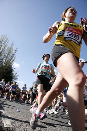London, UK - April 22, 2012: Runners in London Marathon. The London Marathon is next to New York, Berlin, Chicago and Boston to the World Marathon Majors, the Champions League in the marathon. Stock Photo - 13745316