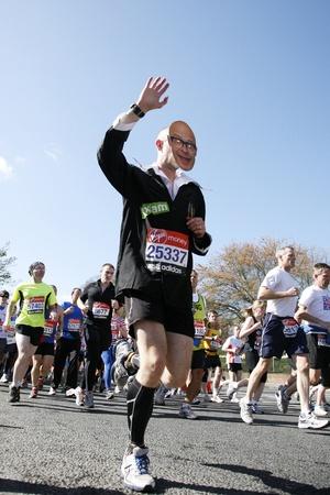 London, UK - April 22, 2012: Runners in London Marathon. The London Marathon is next to New York, Berlin, Chicago and Boston to the World Marathon Majors, the Champions League in the marathon. Stock Photo - 13745297