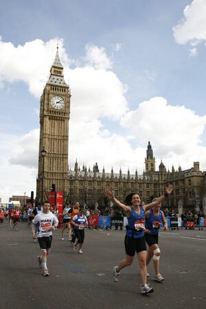 London, UK - April 22, 2012: Runners in London Marathon. The London Marathon is next to New York, Berlin, Chicago and Boston to the World Marathon Majors, the Champions League in the marathon. Stock Photo - 13745293