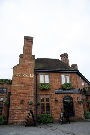 London, UK - May 19, 2012: Outside view of a public house, known as pub, for drinking and socializing, is the focal point of the community, Pub business, now about 53,500 pubs in the UK, has been declining every year.