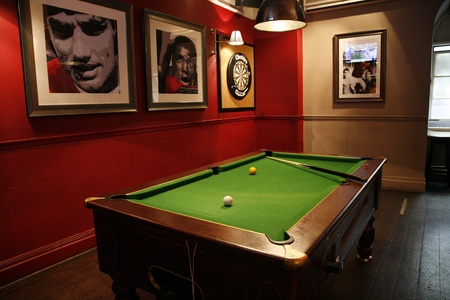 billard: London, UK - April 30, 2012: Inside view of a public house, known as pub, for drinking and socializing, is the focal point of the community, Pub business, now about 53,500 pubs in the UK, has been declining every year.   Editorial