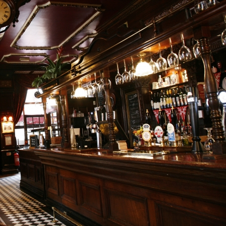 tavern: London, UK - May 5, 2012: Inside view of a public house, known as pub, for drinking and socializing, is the focal point of the community, Pub business, now about 53,500 pubs in the UK, has been declining every year.