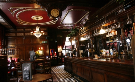 bar interior: London, UK - May 5, 2012: Inside view of a public house, known as pub, for drinking and socializing, is the focal point of the community, Pub business, now about 53,500 pubs in the UK, has been declining every year.