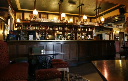 London, UK - May 16, 2012: Inside view of a public house, known as pub, for drinking and socializing, is the focal point of the community, Pub business, now about 53,500 pubs in the UK, has been declining every year.
