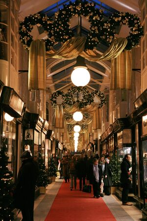 bond street: London, UK - December 21, 2010: Inside view of Burlington Arcade, 19th century European shopping gallery, behind Bond Street from Piccadilly through to Burlington Gardens, opened in 1819 for the sale of jewellery and fancy articles.