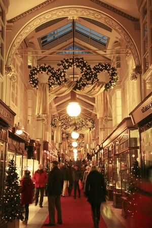 London, UK - December 21, 2010: Inside view of Burlington Arcade, 19th century European shopping gallery, behind Bond Street from Piccadilly through to Burlington Gardens, opened in 1819 for the sale of jewellery and fancy articles.