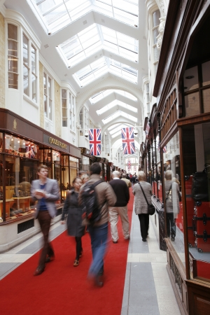 bond street: London, UK - June 4, 2012: Inside view of Burlington Arcade, 19th century European shopping gallery, behind Bond Street from Piccadilly through to Burlington Gardens, opened in 1819 for the sale of jewellery and fancy articles.