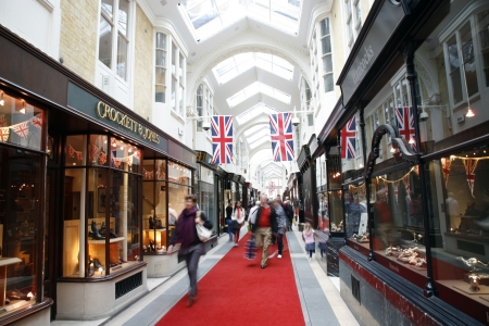 piccadilly: London, UK - June 4, 2012: Inside view of Burlington Arcade, 19th century European shopping gallery, behind Bond Street from Piccadilly through to Burlington Gardens, opened in 1819 for the sale of jewellery and fancy articles.